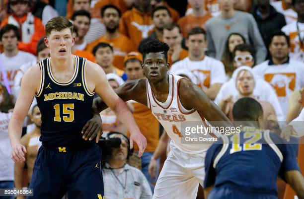 Mohamed Bamba of the Texas Longhorns defends Jon Teske of the Michigan Wolverines at the Frank Erwin Center on December 12 2017 in Austin Texas