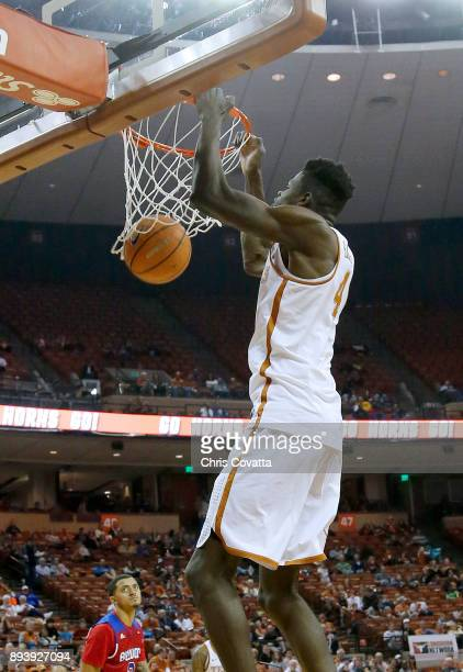 Mohamed Bamba of the Texas Longhorns dunks the ball against the Louisiana Tech Bulldogs at the Frank Erwin Center on December 16 2017 in Austin Texas