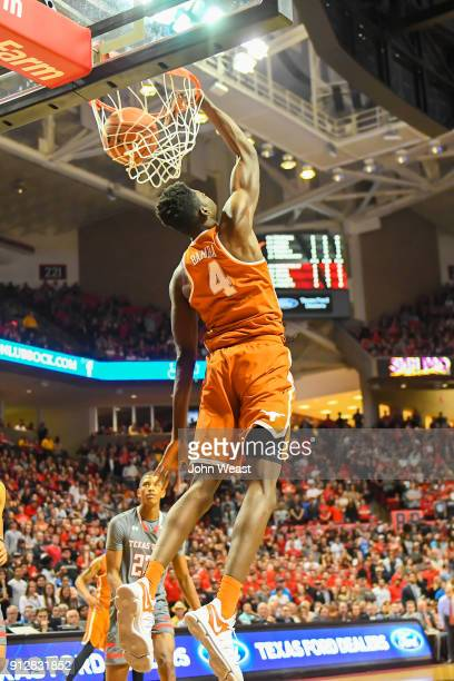Mohamed Bamba of the Texas Longhorns dunks the basketball during the first half of the game against the Texas Tech Red Raiders on January 31 2018 at...