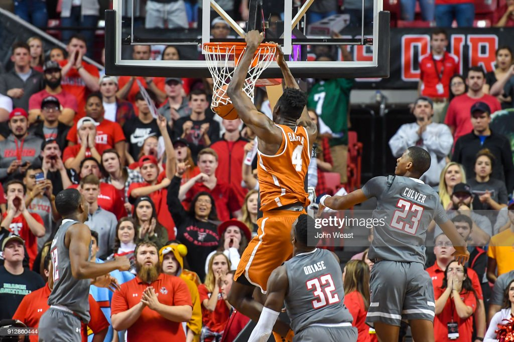 Mohamed Bamba #4 of the Texas Longhorns dunks the basketball during the game against the Texas Tech Red Raiders on January 31, 2018 at United Supermarket Arena in Lubbock, Texas. Texas Tech defeated Texas 73-71 in overtime.