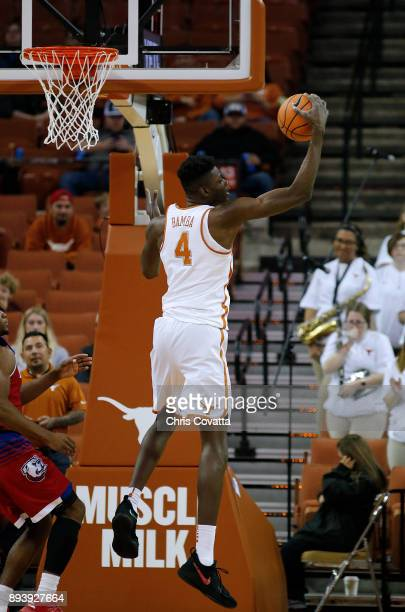Mohamed Bamba of the Texas Longhorns grabs a rebound against the Louisiana Tech Bulldogs at the Frank Erwin Center on December 16 2017 in Austin Texas