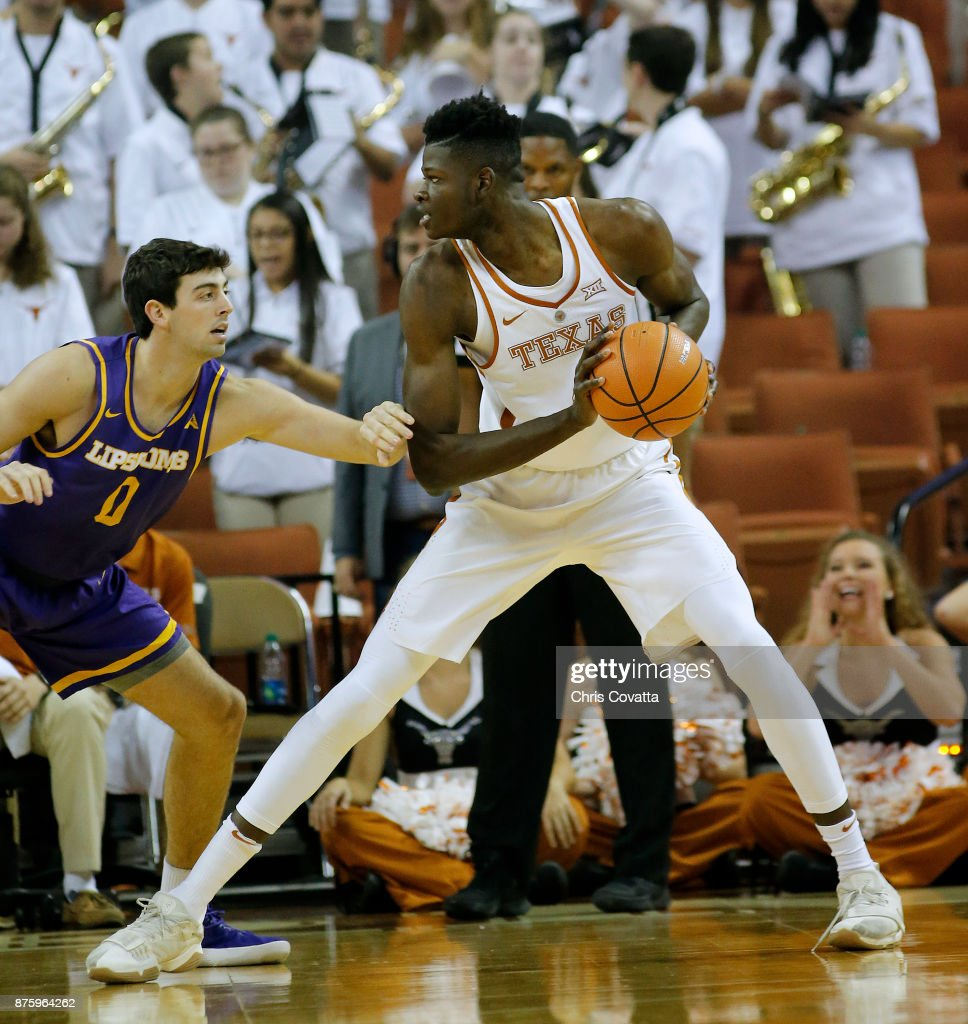 Mohamed Bamba #4 of the Texas Longhorns holds the ball away from Rob Marberry #0 of the Lipscomb Bisons at the Frank Erwin Center on November 18, 2017 in Austin, Texas.