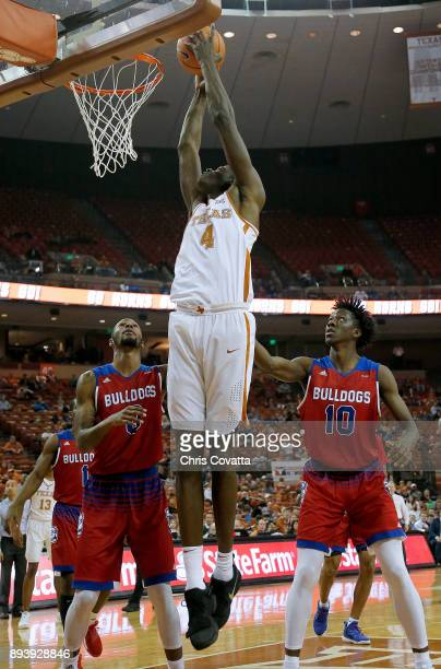 Mohamed Bamba of the Texas Longhorns leaps to the basket against Jacobi Boykins and Anthony Duruji of the Louisiana Tech Bulldogs at the Frank Erwin...