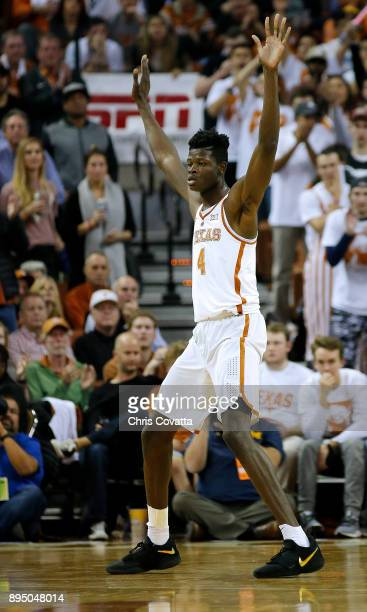 Mohamed Bamba of the Texas Longhorns plays defense against the Michigan Wolverines at the Frank Erwin Center on December 12 2017 in Austin Texas