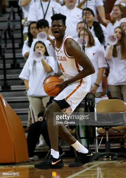 Mohamed Bamba of the Texas Longhorns reacts during the game with the Michigan Wolverines at the Frank Erwin Center on December 12 2017 in Austin Texas