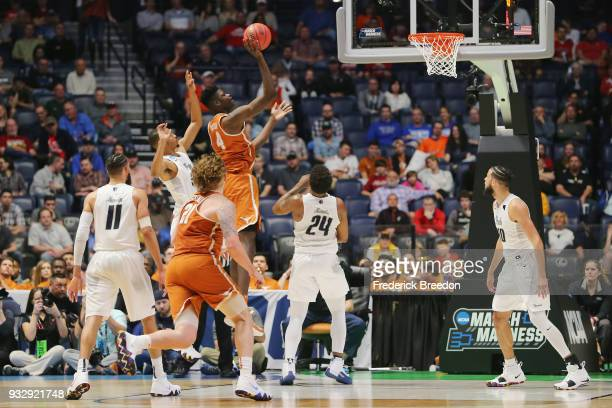 Mohamed Bamba of the Texas Longhorns shoots a floater against the Nevada Wolf Pack during the game in the first round of the 2018 NCAA Men's...