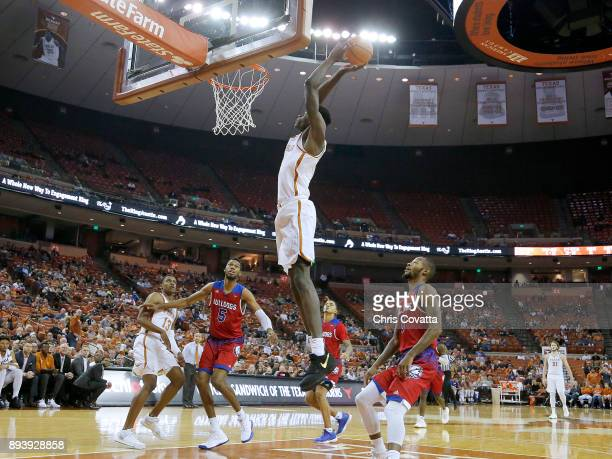 Mohamed Bamba of the Texas Longhorns slam dunks while surrounded by Joniah White Jalen Harris and Jacobi Boykins of the Louisiana Tech Bulldogs of...