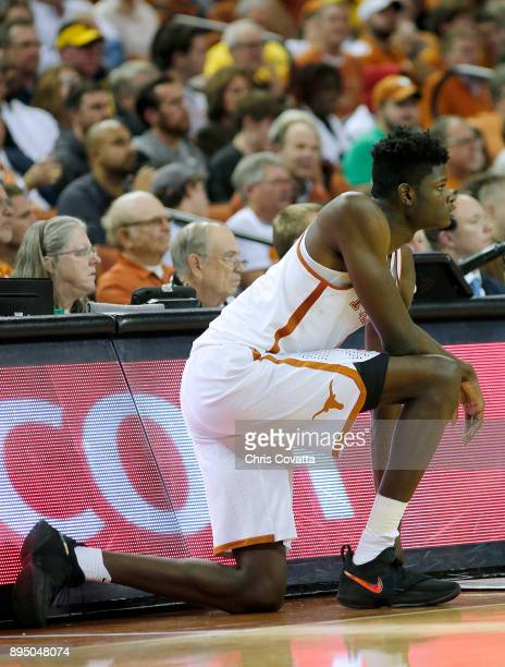 Mohamed Bamba of the Texas Longhorns waits to enter the game against the Michigan Wolverines at the Frank Erwin Center on December 12 2017 in Austin...