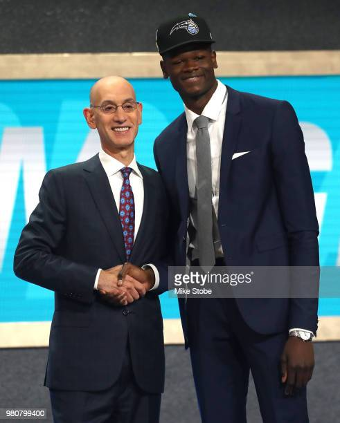 Mohamed Bamba poses with NBA Commissioner Adam Silver after being drafted sixth overall by the Orlando Magic during the 2018 NBA Draft at the...