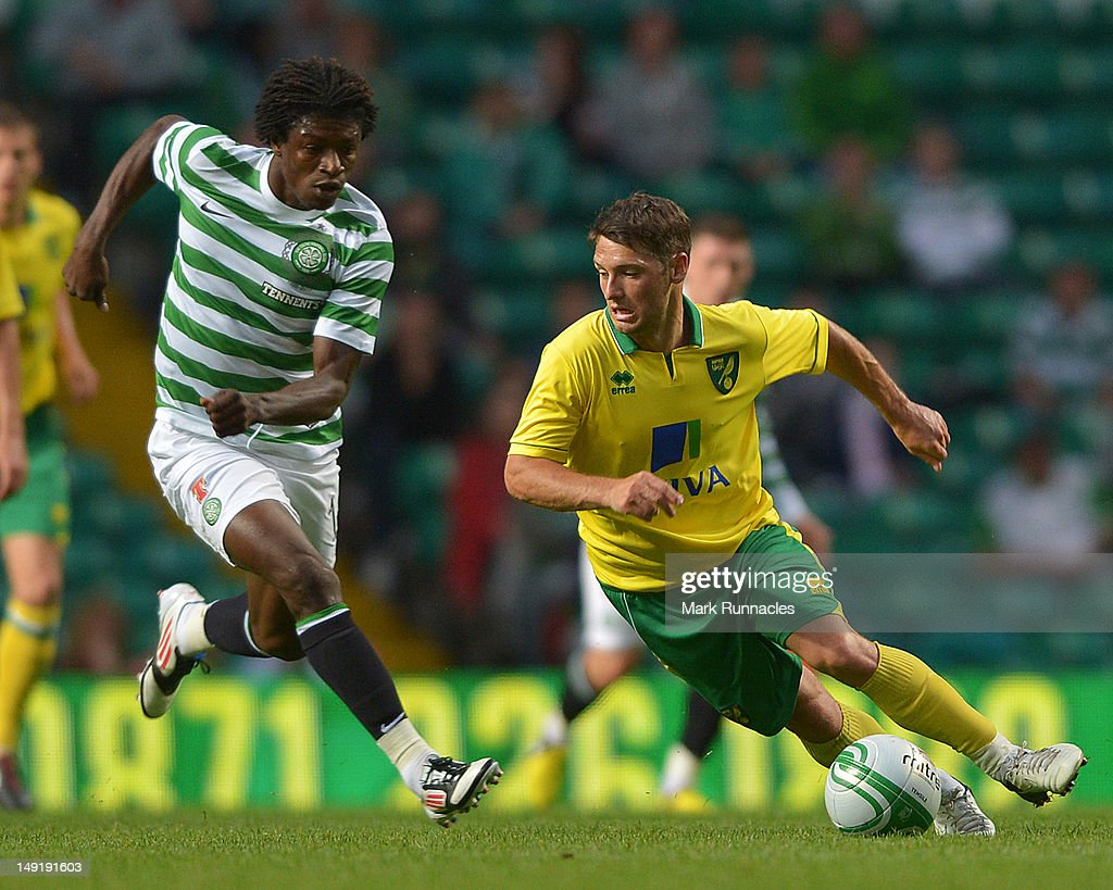 Mohamed Bangura of Celtic and Wes Hoolahan of Norwich City during the pre-season friendly match between Celtic and Norwich City, at ParkHead Stadium on July 24, 2012 in Glasgow, Scotland.