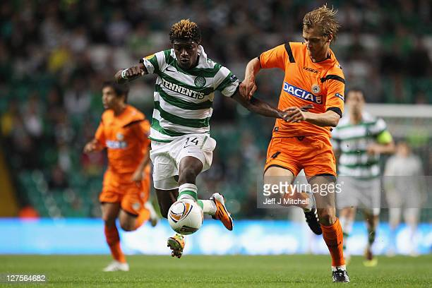 Mohamed Bangura of Celtic tackles Lars Joel Ekstrand of Udinese during the Europa League Group I match between Celtic and Udinese at Celtic Park on...