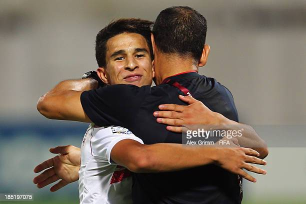 Mohamed Ben Larbi of Tunisia celebrates his team's second goal with head coach Abdelhay Ben Soltane during the FIFA U17 World Cup UAE 2013 Group D...