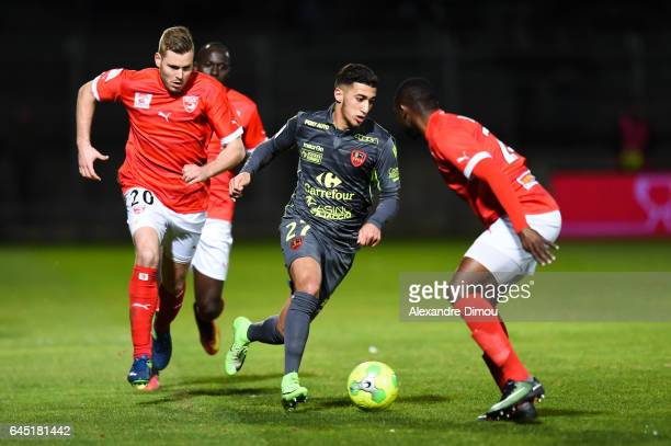 Mohamed Benrahma of Gazelec and Renaud Ripart and Sada Thioub of Nimes during the French Ligue 2 match between Nimes and Gazelec Ajaccio on February...