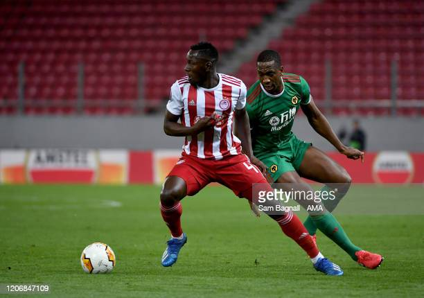 Mohamed Camara of Olympiacos FC and Willy Boly of Wolverhampton Wanderers during the UEFA Europa League round of 16 first leg match between...