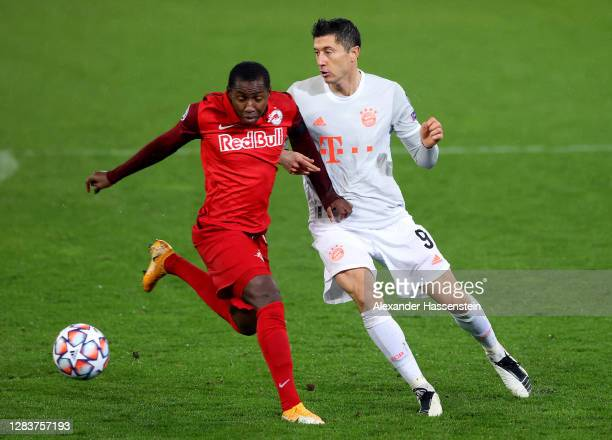 Mohamed Camara of RB Salzburg and Robert Lewandowski during the UEFA Champions League Group A stage match between RB Salzburg and FC Bayern Muenchen...