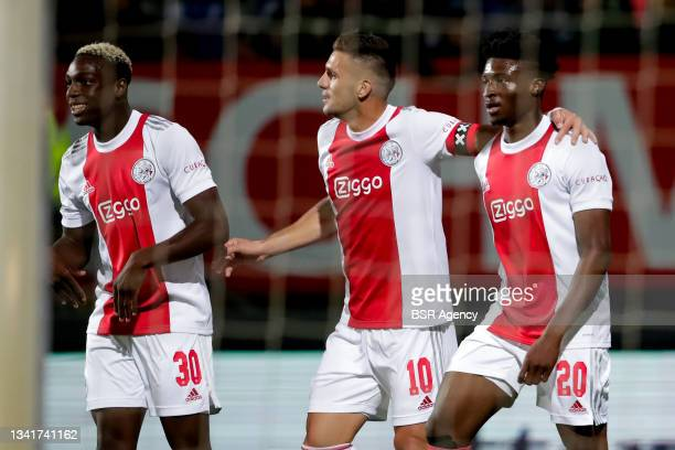 Mohamed Daramy of Ajax, Dusan Tadic of Ajax and Mohammed Kudus of Ajax celebrate their sides fourth goal during the Dutch Eredivisie match between...