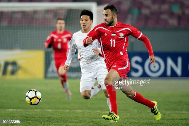 Mohamed Darwish of Palestine follows the ball during the AFC U23 Championship Group B match between Palestine and North Korea at Jiangyin Stadium on...