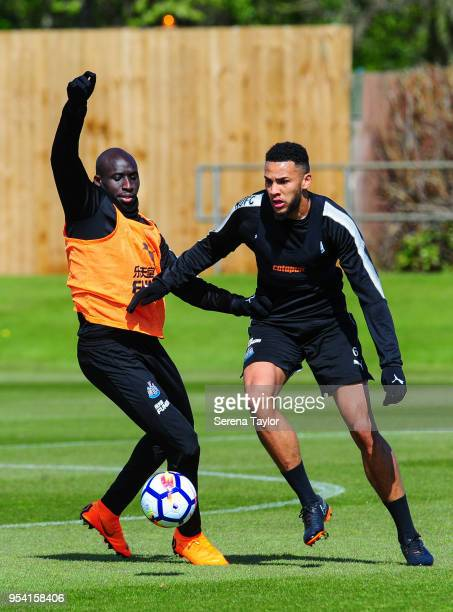 Mohamed Diame and Jamaal Lascelles jostle for the ball during the Newcastle United Training Session at the Newcastle United Training Centre on May 3...