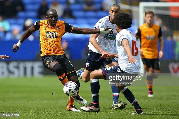 Mohamed Diame of Hull City and Derik Osede of Bolton Wanderers compete for the ball during the Sky Bet Championship match between Bolton Wanderers...