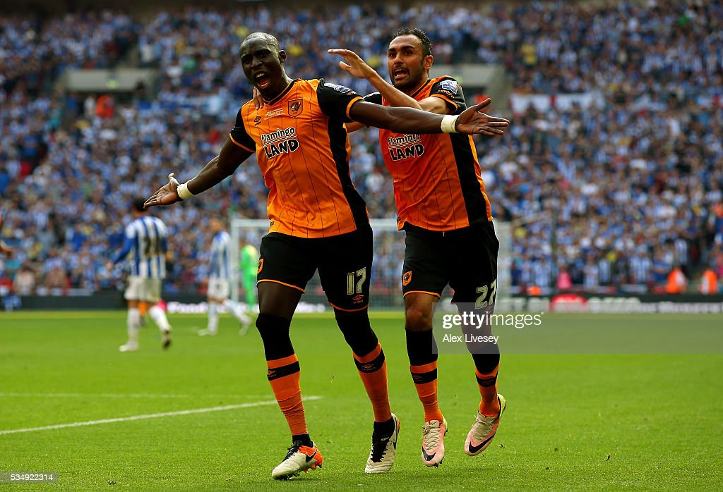 Mohamed Diame (L) of Hull City celebrates scoring his team's first goal with his team mate Ahmed Elmohamady (R) during Sky Bet Championship Play Off Final match between Hull City and Sheffield Wednesday at Wembley Stadium on May 28, 2016 in London, England.