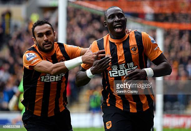 Mohamed Diame of Hull City celebrates with teammate Ahmed Elmohamady after scoring the opening goal during the Barclays Premier League match between...