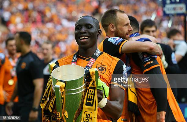 Mohamed Diame of Hull City celebrates with the trophy after victory in during Sky Bet Championship Play Off Final match between Hull City and...