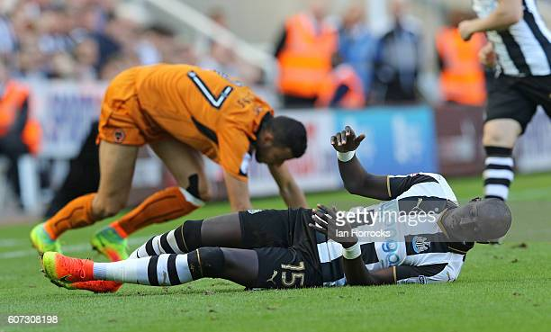 MatzNEWCASTLE UPON TYNE ENGLAND SEPTEMBER 17 Mohamed Diame of Newcastle is brought down by Romain Saiss of Wolves during the Sky Bet Championship...