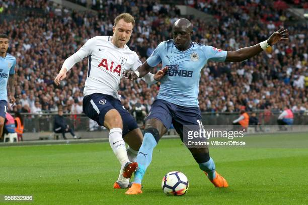 Mohamed Diame of Newcastle stretches to block Christian Eriksen of Tottenham during the Premier League match between Tottenham Hotspur and Newcastle...