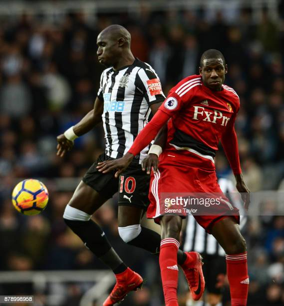 Mohamed Diame of Newcastle United and Abdoulaye Doucoure of Watford jostle for the ball during the Premier League match between Newcastle United and...