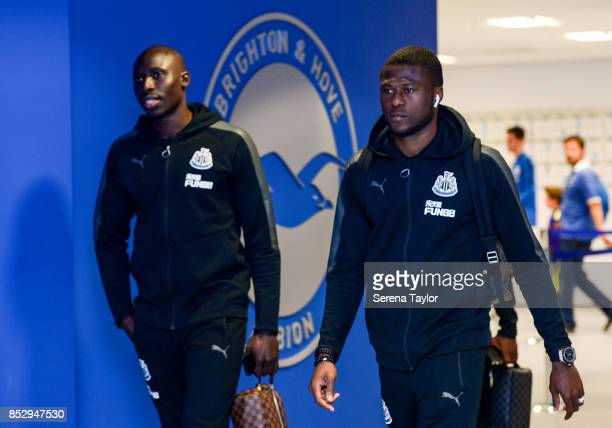 Mohamed Diame of Newcastle United and Chancel Mbemba arrives before kick off in the Premier League match between Brighton and Hove Albion and...