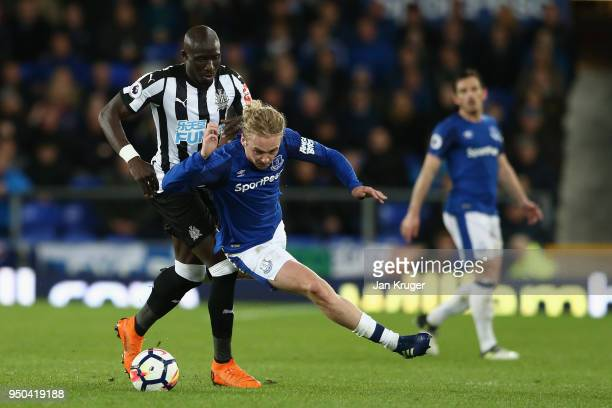 Mohamed Diame of Newcastle United and Tom Davies of Everton in action during the Premier League match between Everton and Newcastle United at...