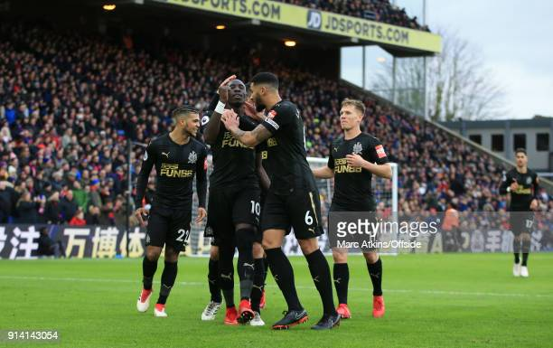 Mohamed Diame of Newcastle United celebrates scoring the opening goal with team mates during the Premier League match between Crystal Palace and...