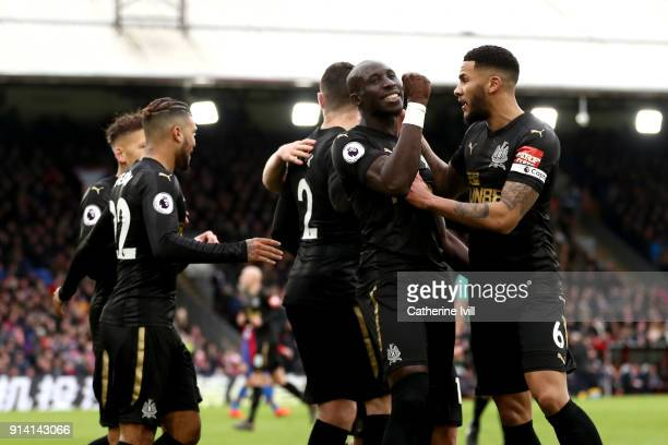 Mohamed Diame of Newcastle United celebrates with teammates after scoring his sides first goal during the Premier League match between Crystal Palace...