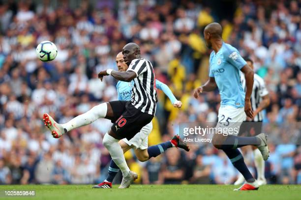Mohamed Diame of Newcastle United clears the ball during the Premier League match between Manchester City and Newcastle United at Etihad Stadium on...
