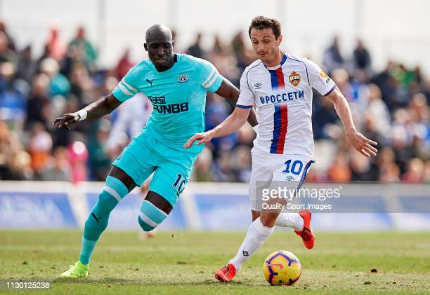 Mohamed Diame of Newcastle United competes for the ball with Alan Dzagoev of CSKA Moscow during the friendly match between Newcastle United and CSKA...
