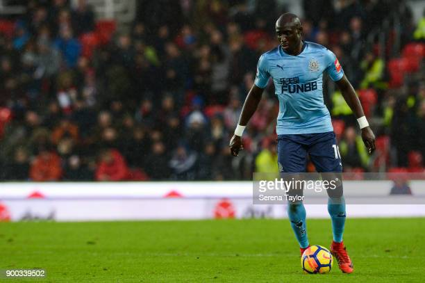 Mohamed Diame of Newcastle United controls the ball after defeating Maxim ChoupoMoting of Stoke City during the Premier League match between Stoke...