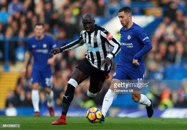 Mohamed Diame of Newcastle United is challenged by Eden Hazard of Chelsea during the Premier League match between Chelsea and Newcastle United at...