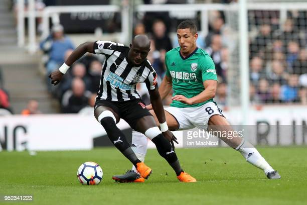 Mohamed Diame of Newcastle United is challenged by Jake Livermore of West Bromwich Albion during the Premier League match between Newcastle United...
