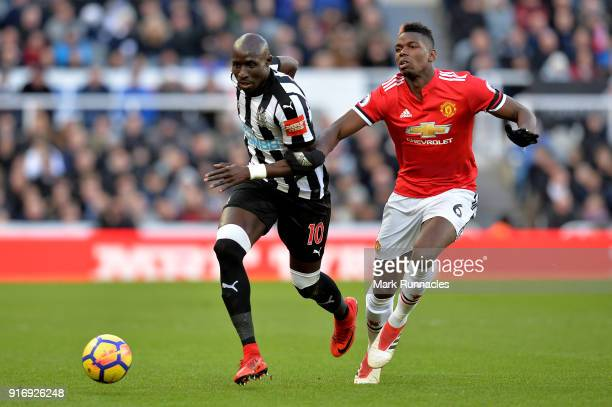 Mohamed Diame of Newcastle United is challenged by Paul Pogba of Manchester United during the Premier League match between Newcastle United and...