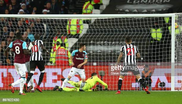 Mohamed Diame of Newcastle United scores his sides second goal during the Premier League match between West Ham United and Newcastle United at London...