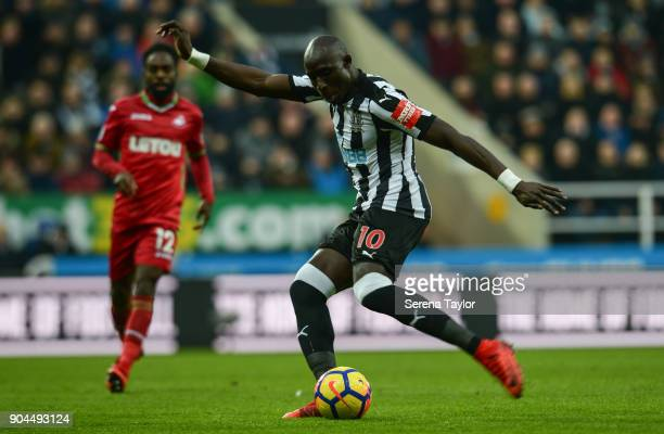 Mohamed Diame of Newcastle United strikes the ball during the Premier League match between Newcastle United and Swansea City at StJames' Park on...