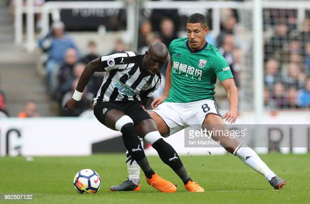 Mohamed Diame of Newcastle United vies with Jake Livermore of West Bromwich Albion during the Premier League match between Newcastle United and West...
