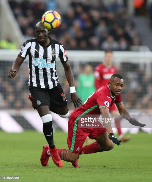 Mohamed Diame of Newcastle United vies with Jordan Ayew of Swansea City during the Premier League match between Newcastle United and Swansea City at...