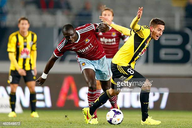 Mohamed Diame of West Ham and Alex Gorrin of the Phoenix contest the ball during the Football United New Zealand Tour match between the Wellington...