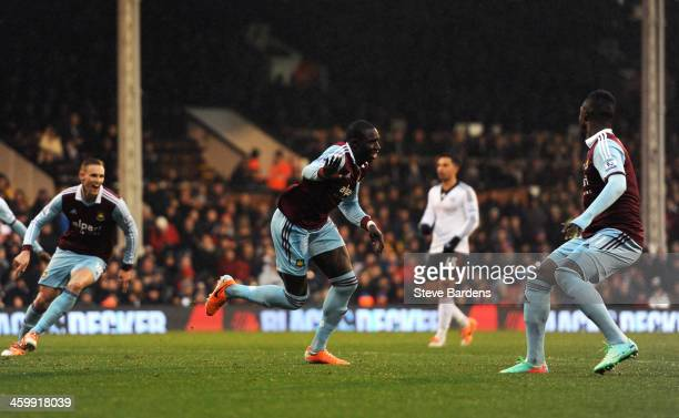 Mohamed Diame of West Ham celebrates after scoring the opening goal during the Barclays Premier League match between Fulham and West Ham United at...