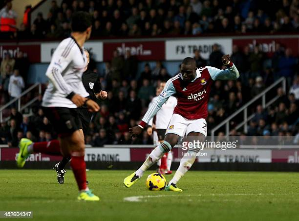 Mohamed Diame of West Ham United shoots to score the first goal during the Barclays Premier League match between West Ham United and Fulham at Boleyn...