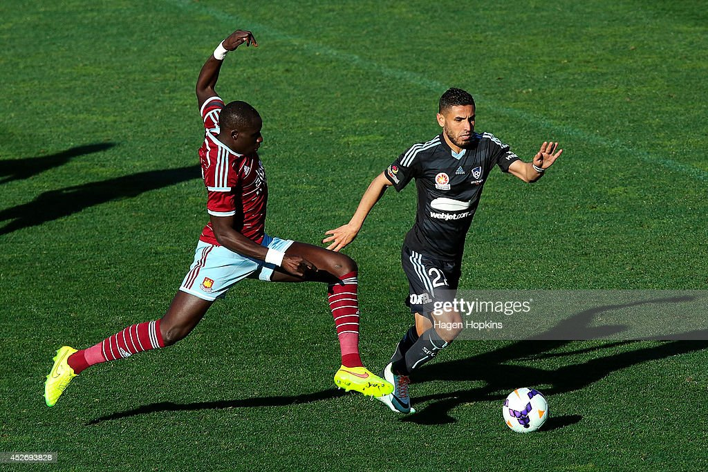 Mohamed Diame of West Ham United tackles Ali Abbas of Sydney FC during the Football United New Zealand Tour 2014 match between Sydney FC and West Ham United at Westpac Stadium on July 26, 2014 in Wellington, New Zealand.