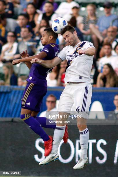 Mohamed ElMunir of Orlando City SC and Dave Romney of the Los Angeles Galaxy fight for control of the ball at StubHub Center on July 29 2018 in...