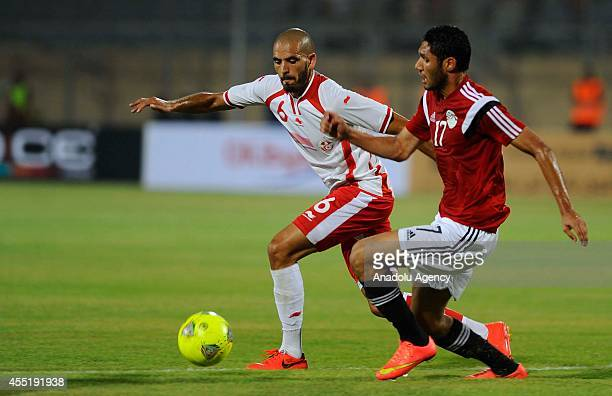 Mohamed ElNenny of Egypt in action against Hussein Alrajhy of Tunisia during the African Cup of Nations qualifiers group G soccer match between Egypt...