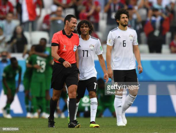 Mohamed Elneny and Ahmed Hegazy of Egypt talk with Referee Wilmar Roldan as he checks with VAR concerning a penalty for Saudi Arabia during the 2018...